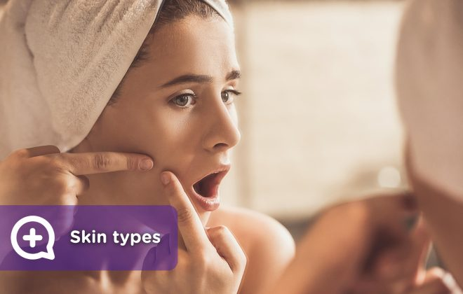 Woman in the mirror touching the skin on her face, pimples, acne, atopic skin, seborrheic, oily skin, mixed skin, dry skin.