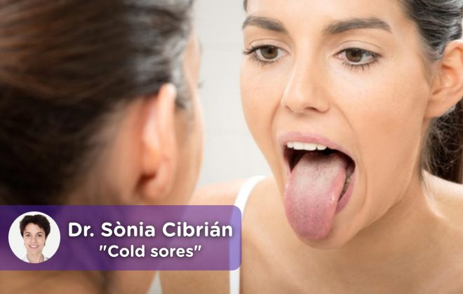 Woman looking in the mirror at her tongue with cold or canker sores.